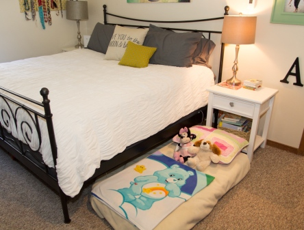 Our room and Little A's nook and trundle bed. The bright side - How fun that we get to have a trundle bed in our adult room. We don't even have to make it in the morning. Just push it out of sight.